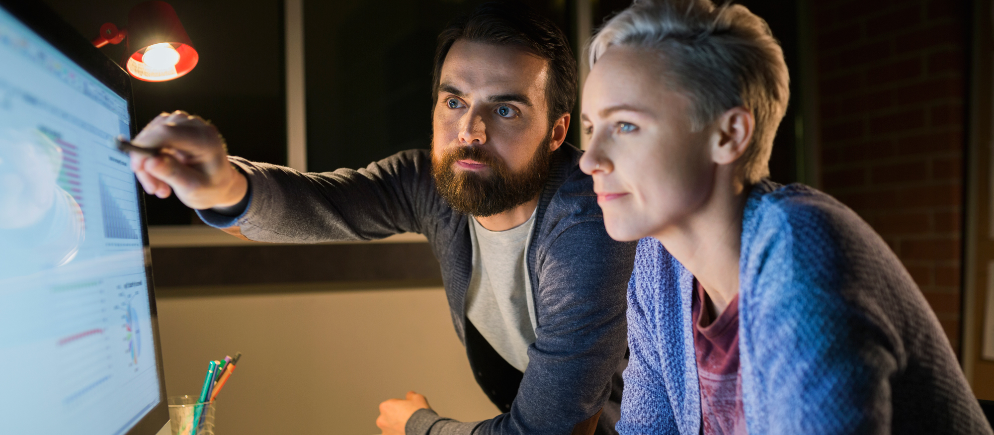 Woman and man looking at a computer screen.
